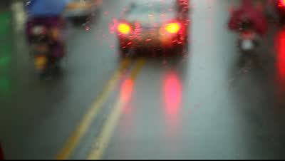 stock-footage-traffic-on-a-raining-day-near-dusk